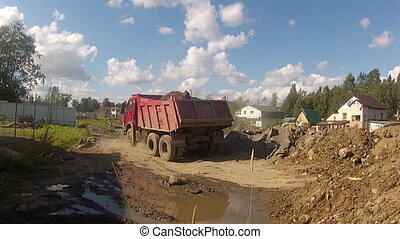 Truck unloading on building site