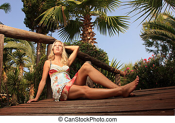 Young and sexy model in tropical environment