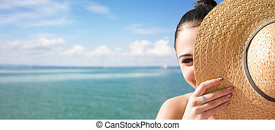 Young brunette relaxing at the beach - Sunny portrait of a...
