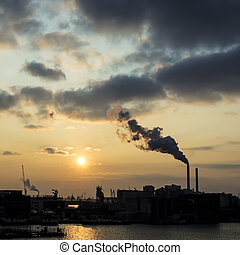 industrial sunset - skyline of the western docklands of...