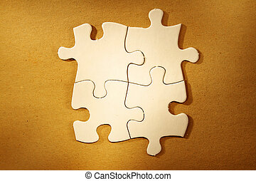 Jigsaw puzzle pieces - Four jigsaw puzzle pieces connected