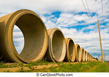 Cement Tubes - Multiple Cement Tubes lined up in a row