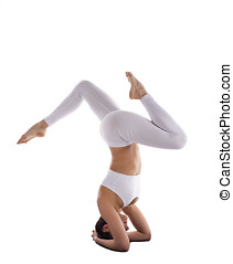 strong yoga woman in white stand on head asana - young woman...
