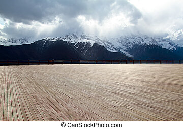 Wood floor with background mountain - Wood floor with a...