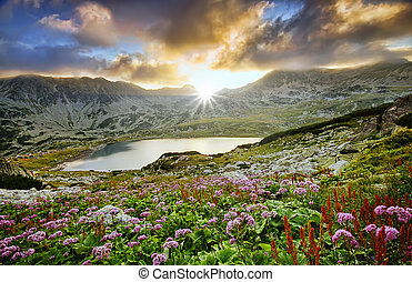 mystic mountain sunset with lake in