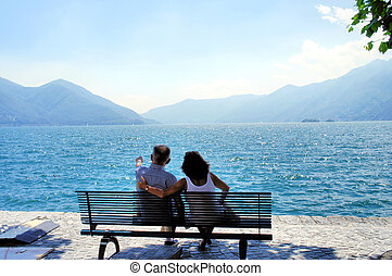 In love at the Lago Maggiore - A man and a woman sitting on...