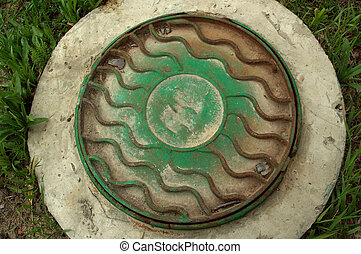 Cast iron cover for a well
