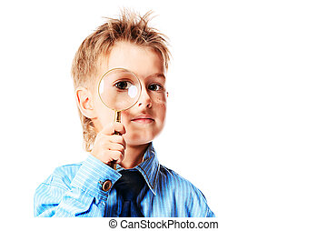 magnifying glass - Curious little boy in spectacles is...