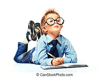 thinking kid - Little boy in spectacles and suit lying on a...