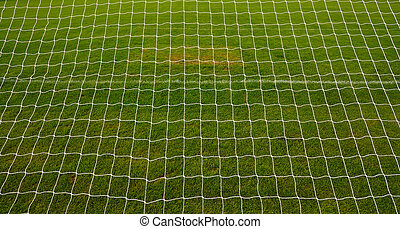 goal net background with grass football pitch or soccer...