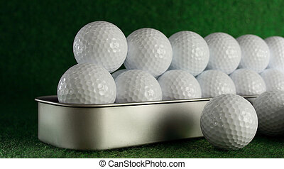 Golfballs waiting for a very long ride