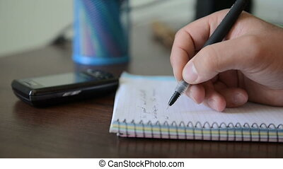 Businessman writes down ideas. HD