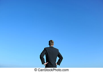 In charge - Businessman and blue sky. Above space for text...