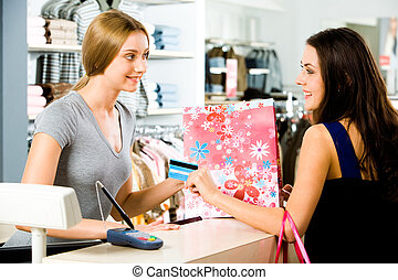 Selling - Image of salesperson selling something to...