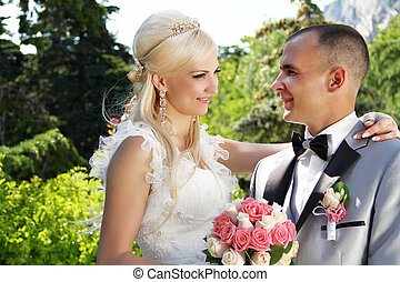 The bride and groom in the spring nature close-up portrait