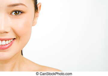 Smiling woman - Closeup of half face of young fresh woman...