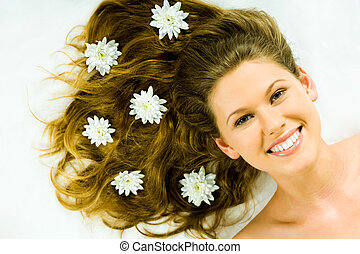 Beauty with flowers - Portrait of a happy fresh girl with...
