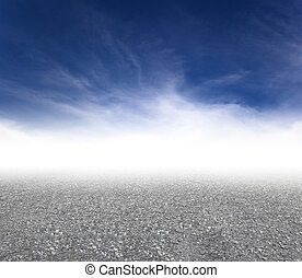 gray asphalt road with cloud background