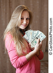 Happy woman with bundles of US dollars - Happy young woman...