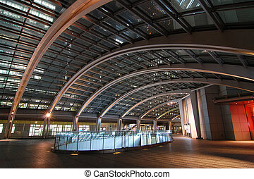 modern architecture interior - big hall with arc glass roof...
