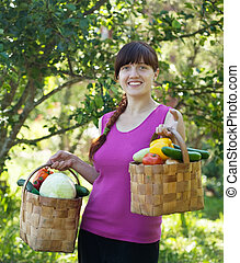 girl with vegetables  in garden