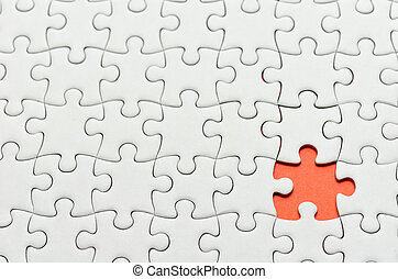 Jigsaw puzzle - Plain white jigsaw puzzle, on orange...