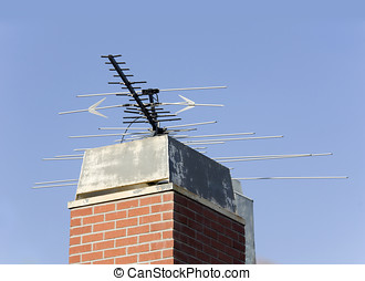 Old style TV antenna - A large metal TV antenna sits on top...