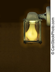 Porch light shining bright - Incandescent light bulb in an...