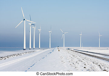 Long row of windturbines in a Dutch winter landscape
