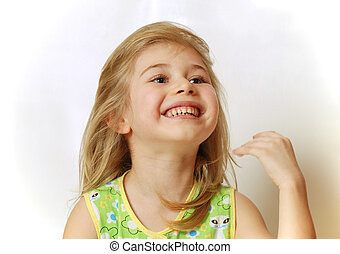 Little blond girl laughs - Little blond girl with overturned...