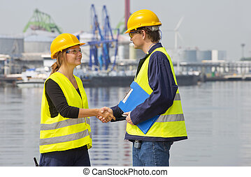 Greeting harbor workers - Two dockers greeting eachother in...