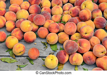 peaches in wooden crate - Ripe peaches in wooden crate at...