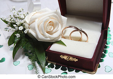 Wedding rings and rose - Engagement ring in a box with a...