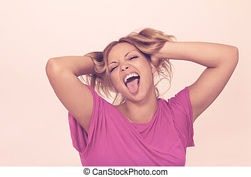 Young woman making funny faces - Crazy humorous girl...