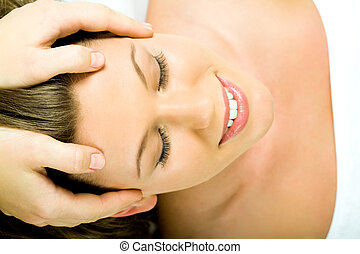 Face massage - Closeup of smiling female�s face with...