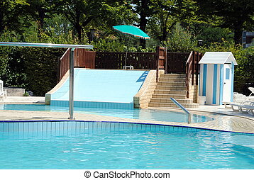limpid swimming pool and a waterslide without people