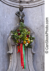 Manneken Pis (Peeing Boy) in Brussels - The famous Manneken...