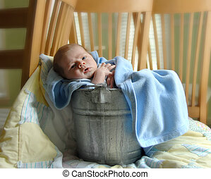 Awake and Contented - Tiny baby relaxes in a rustic aluminum...