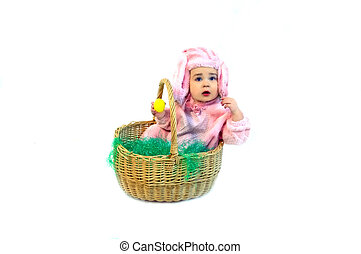 Basket Bunny - Pink Easter bunny finds an yellow egg in the...