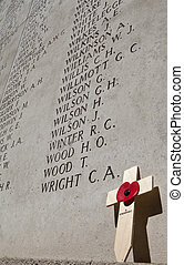 Names on the Menin Gate in Ypres - A Poppy, cross and names...
