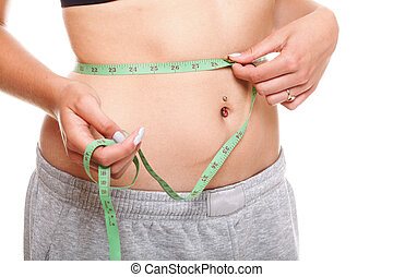 woman slim stomach with measuring tape around it - Close-up...