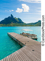 Bora bora deck - Wood deck with turquoise water in Tahiti.