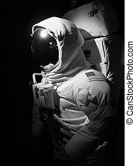 space man - An astronaut set up under dramatic lighting -...