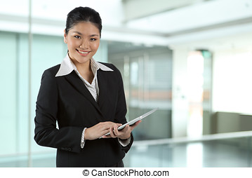 Asian business woman with touch pad PC