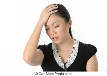Asian woman with headache - Asian woman holding head whilst...