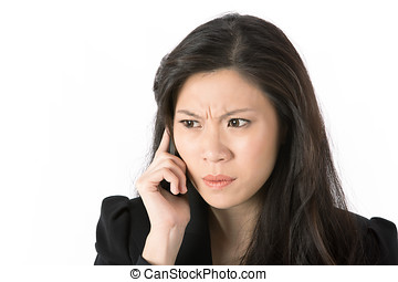 Angry businesswoman talking on smart phone - Angry Asian...