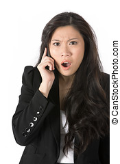 Angry business woman on phone. - Angry Asian business woman...