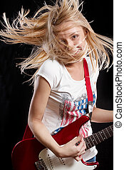 Woman Playing the Guitar - Woman playing the electrical...