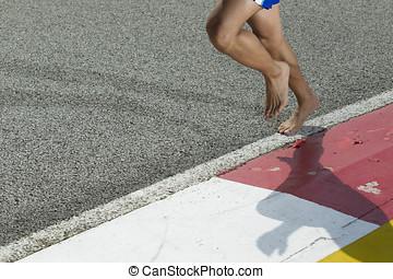 Closeup of a runners feet barefoot running - A closeup of a...