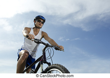 Cyclist riding a bicycle - Portrait of a happy Asian man...